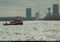 Yet another ice-breaker type boat on duty on the Niagara River, with the Canadian' Niagara Falls City on the background