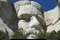 Not in a city : Mount Rushmore National Memorial sculpture by Gutzon Borglum represents the first 150 years of the history of the United States of America. Featuring 60-foot/18 m sculptures of the heads of former United States Presidents, here Theodore Roosevelt. The precision of the craving is just amazing!
