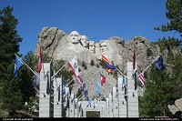 Not in a city : Flags Avenue at Mount Rushmore. Every pillars supports several states flags, with the date of the acceptance within the Union