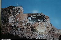 Not in a city : A rendering of the final shape of Crazy Horse carved in the moutain, once done. Started in 1947 by Korczak Ziolkowski to celebrate all Native Americans, it will take decades to achieve it.