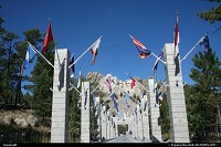 Flags Avenue at Mount Rushmore. Every pillars supports several states flags, with the date of the acceptance within Union. Mount Rushmore National Memorial sculpture by Gutzon Borglum represents the first 150 years of the history of the United States of America. Featuring 60-foot/18 m sculptures of the heads of former United States presidents: George Washington, Thomas Jefferson, Theodore Roosevelt and Abraham Lincoln. It's definitively a must to see. It is located on the Black Hills National Forest.