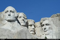 not in a city : Mount Rushmore National Memorial sculpture by Gutzon Borglum represents the first 150 years of the history of the United States of America. Featuring 60-foot/18 m sculptures of the heads of former United States presidents: George Washington, Thomas Jefferson, Theodore Roosevelt and Abraham Lincoln. It's definitively a must to see. It is located on the Black Hills National Forest.
