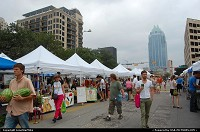 Texas, Austin's Farmers Market at Republic Square on an overcast day. The building to the left is The Plaza Lofts. The silver highrise is Frost Tower, which was once Austin's tallest.