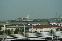 American's Boeig 737 landing in Dallas DFW. Look also at the cargo plane