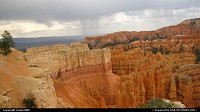 Bryce Canyon Amphitheater with rain showers in the background.