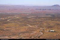 Overview of the unpaved road to the Valley of the Gods from the Mocky Dugway. The house on the right is a bed & breakfast.