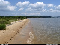 Beach along the James River, Colonial Parkway, near College Creek, outside Williamsburg, Virginia, USA.