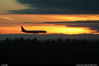 Washington, Another Alaska Airlines Boeing 737 right before landing at SEA'TAC. Amazing sunset.
