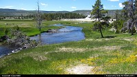 Firehole River with geysers in the background.