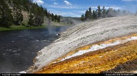 Wyoming, Black Sands Geyser Basin waters flow into the river.